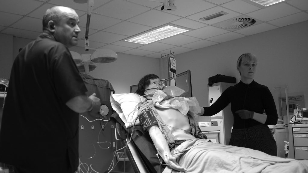 Simulated patient in hospital training room